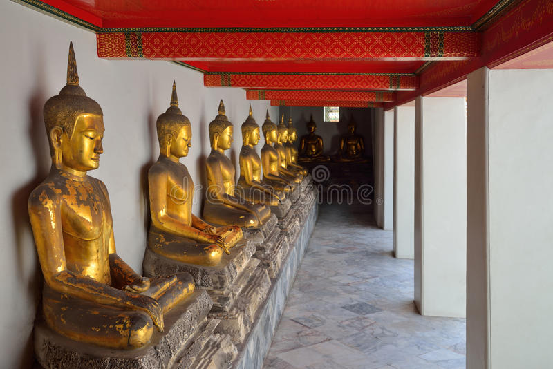 Raw of golden Buddha in Buddhist temple, Wat Pho in Bangkok ,Asia Thailand stock images