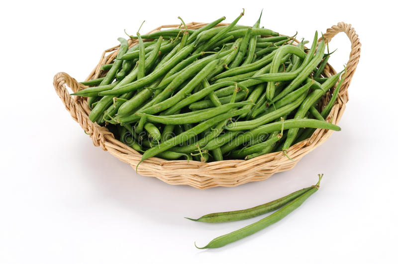 Raw green beans. Green beans in the basket on white background stock photos