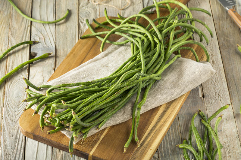 Raw Green Organic Chinese Long Beans. Ready to Cook With stock photo