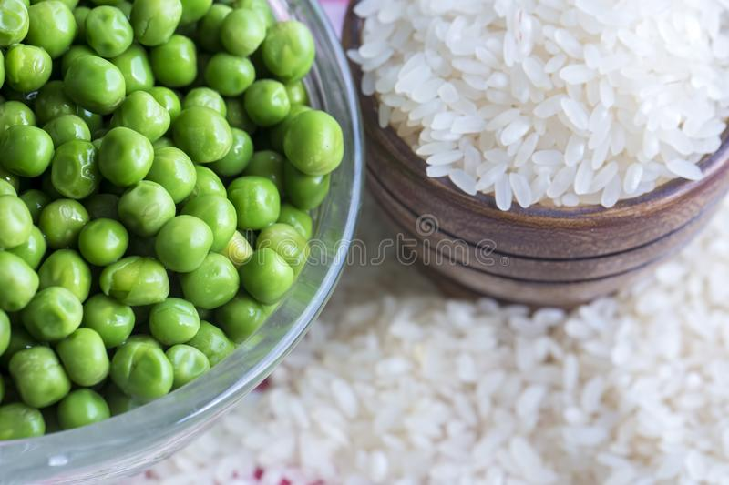 Raw green pea and dried rice. Food concept photo.  royalty free stock photo