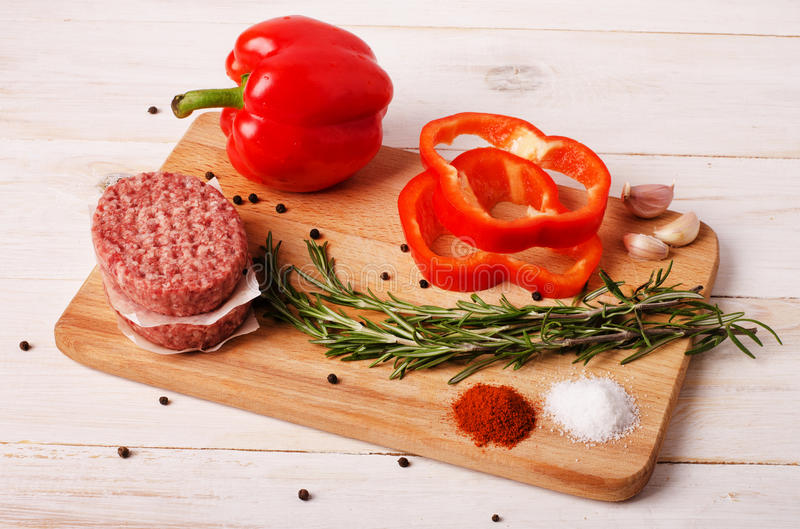 Raw ground beef burgers cutlets royalty free stock images