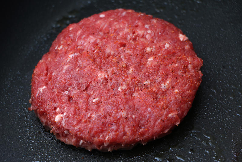 Raw Hamburger on the Skillet stock photos