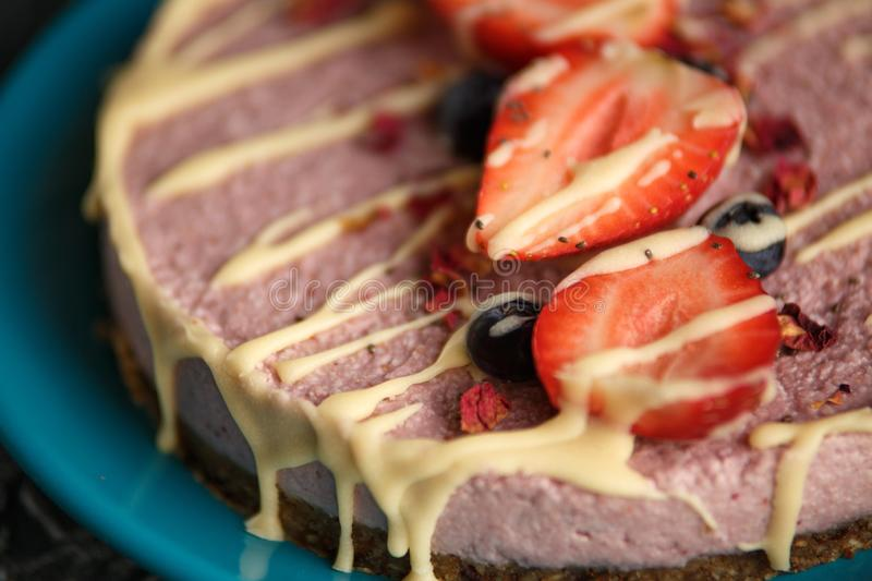Raw healthy vegan cheesecake, homemade with cashew, mint and. Strawberries stock images
