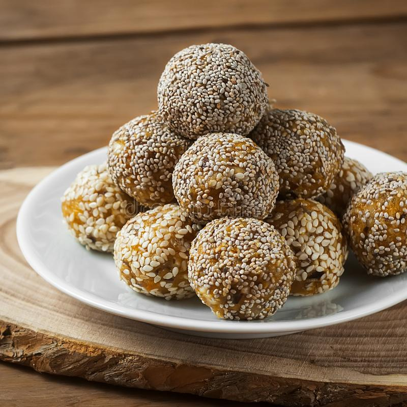 Raw healthy vegetarian and vegan food. Organic snack bites with dried fruits, nuts and honey. Energy balls.  stock photography