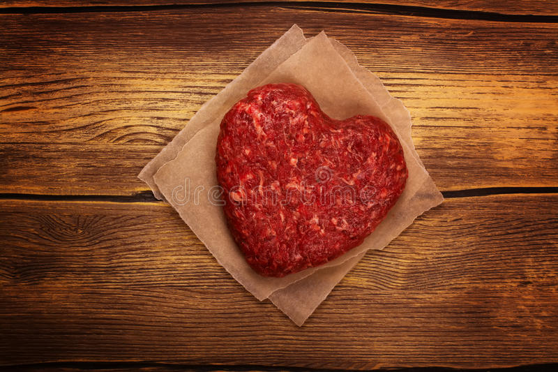 Raw heart shaped burger cutlet stock photos