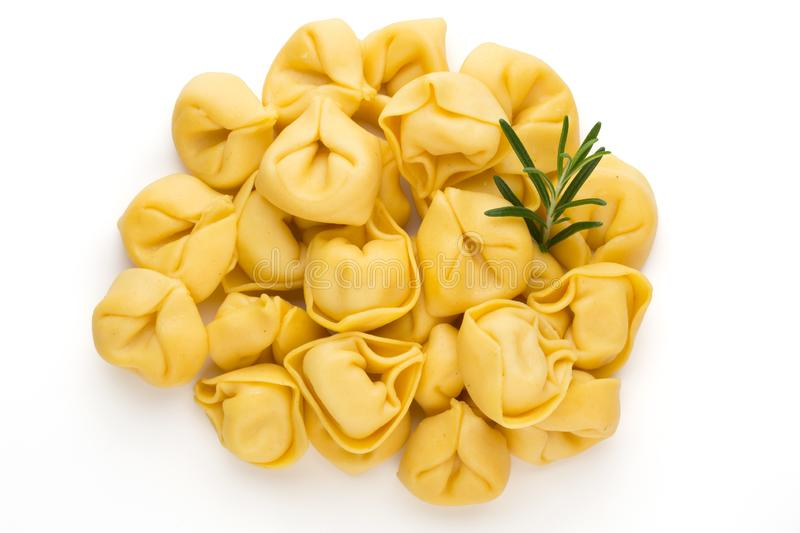 Raw homemade pasta,tortellini with herbs.  royalty free stock images