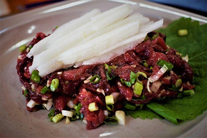 Raw horse meat dish yukhoe in Jeju, Korea stock photo