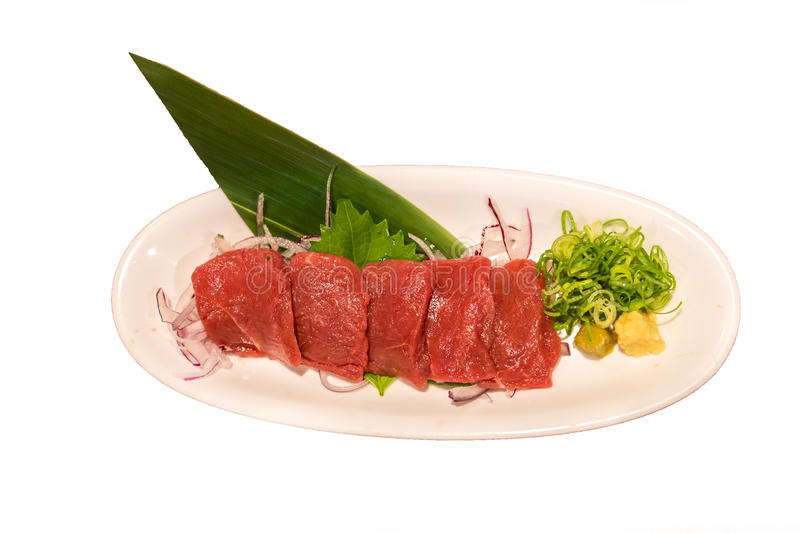 Raw horse meat sashimi plate over white background.  royalty free stock photography