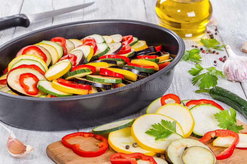 Raw ingredients for traditional French casserole, ratatouille to. Raw ingredients for traditional French casserole, ratatouille: zucchini, red bell pepper royalty free stock photography