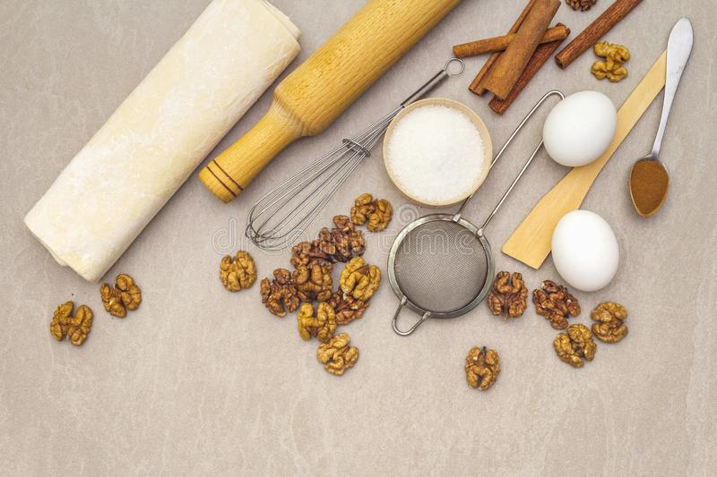 Raw ingredients for walnut pie. Baking concept stock image