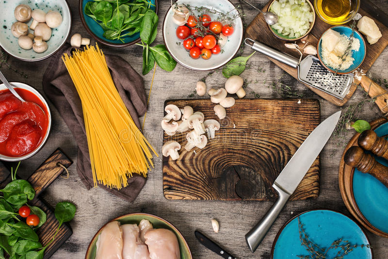 Raw Italian spaghetti and ingredients for cooking pasta royalty free stock photos