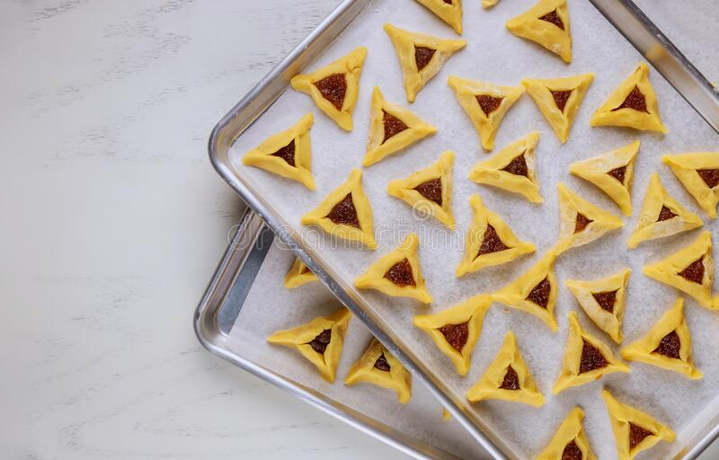 Raw jewish cookies with jam on oven tray stock photos
