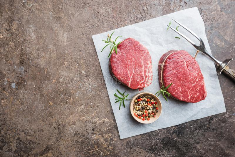 Raw marbled meat steak. Filet Mignon with seasonings over stone background, top view stock photos