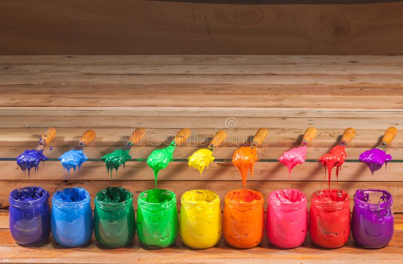 raw material dark blue light blue dark green light green yellow orange pink red and purple colors of plastisol ink royalty free stock photos