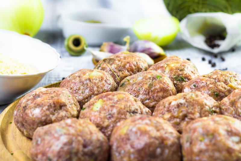 Raw meat balls minced beef prepared roll breadcrumbs stock images