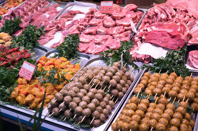 Butcher`s shop. Raw meat in butcher`s shop showcase stock photography