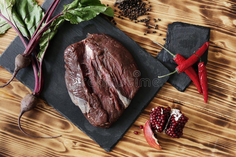 Raw meat. Cooking, preparation. Raw meat on the table stock photo