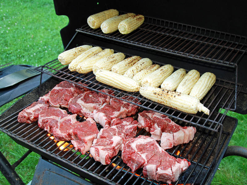Raw Meat With A Corn On The Grill Stock Photos