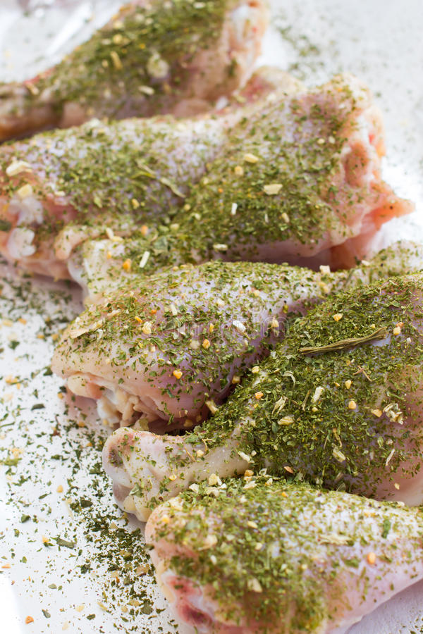 Raw meat. Ready to cook chicken legs. Skinless chicken drumsticks with herbs. Skinless chicken drumsticks with herbs stock image