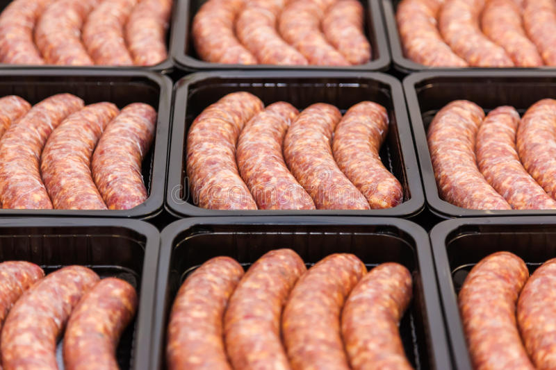 Raw meat sausages in packing box royalty free stock photo