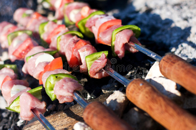 Raw meat skewers. Barbecue with raw meat skewers More skewers here royalty free stock image