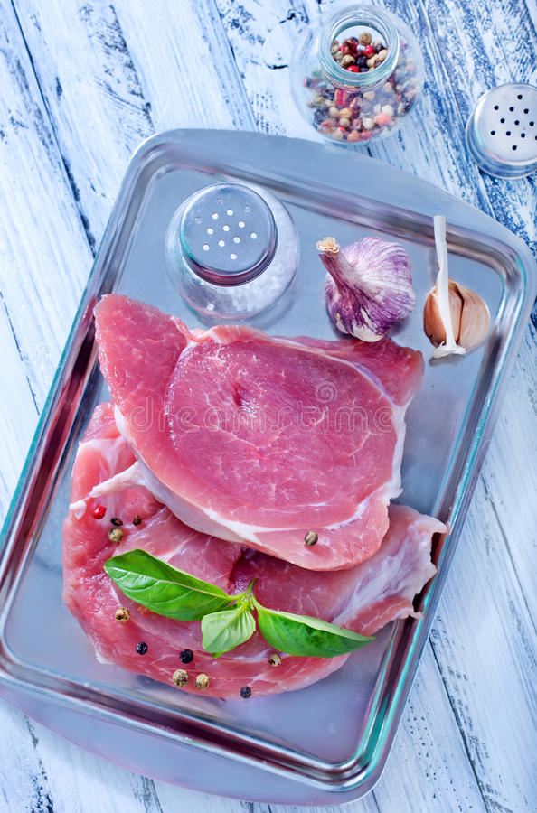 Raw meat. With spice on a table stock photo