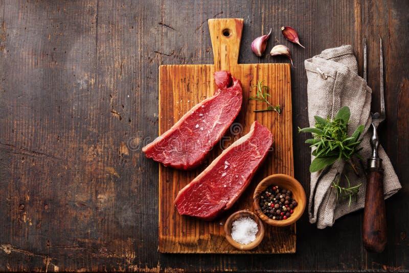 Raw meat Striploin steak and seasoning stock photography