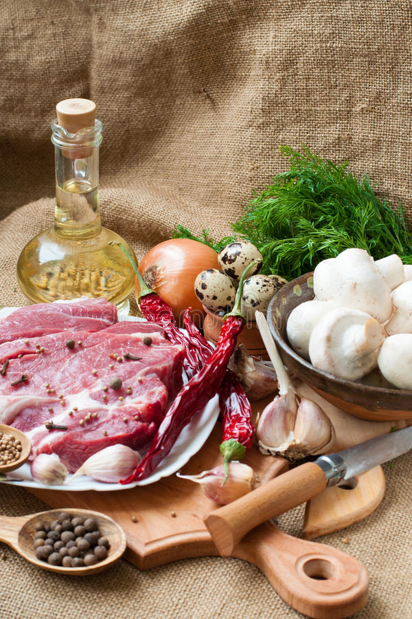 Raw meat, vegetables and spices stock photos