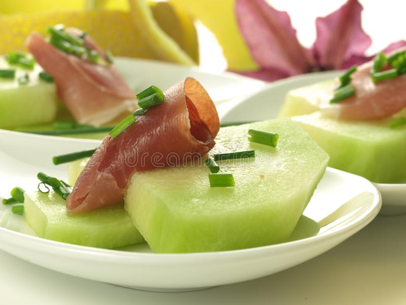 Download Raw melon with ham stock photo. Image of leaves, diet - 32175860