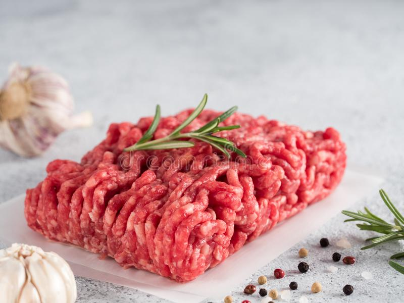 Raw minced beef on light gray cement background royalty free stock photography