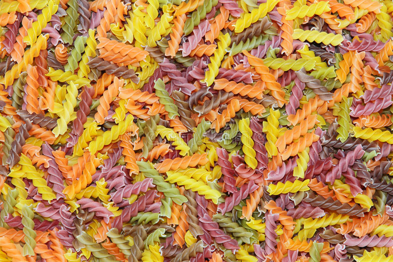 Raw Multicolored Fusilli pasta as food background. royalty free stock photos
