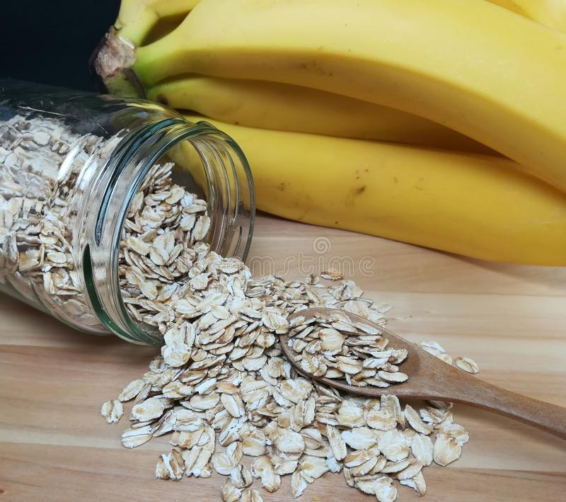 Raw oatmeal is scattered on the desk royalty free stock photo