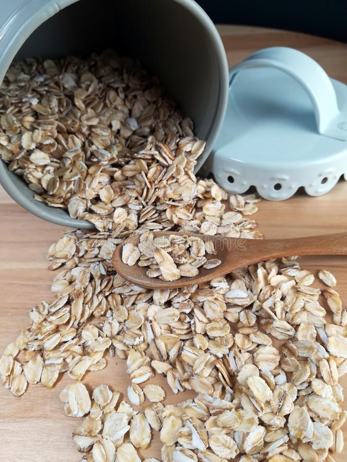 Raw oatmeal is scattered on the desk stock images