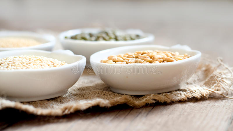 Raw Organic Amaranth and quinoa grains, wheat and mung beans stock image