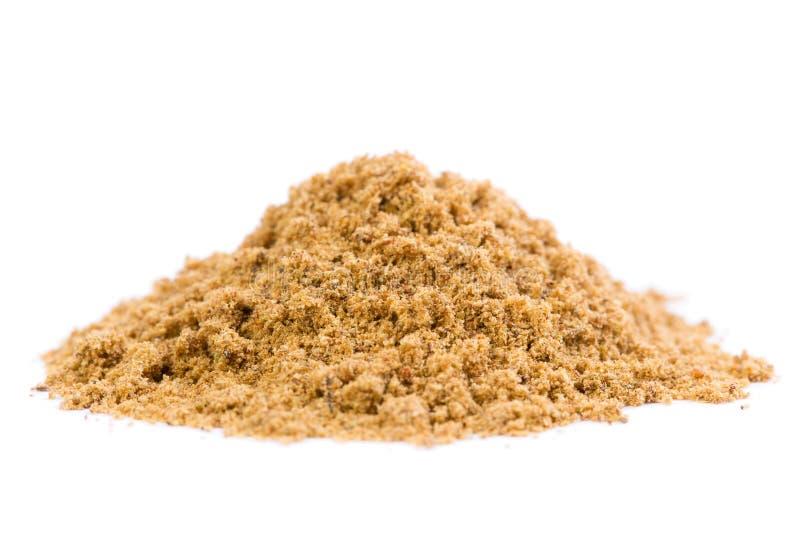Raw Organic Coriander Spice Powder. A heap of raw organic coriander spice powder on white background stock photos