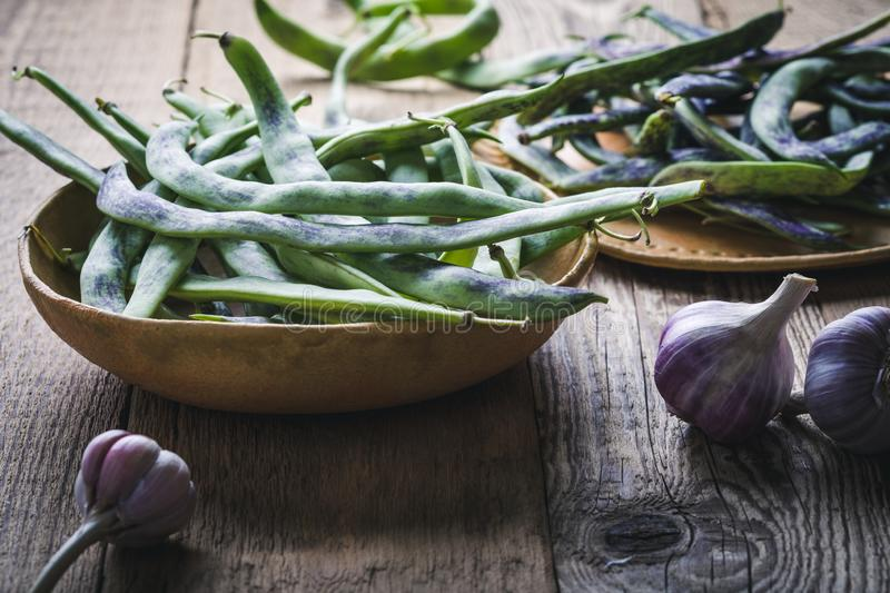 Raw organic rattlesnake beans, plant based food. Raw organic homegrown rattlesnake beans, heirloom vegetables in ceramic plate, plant based food, close up royalty free stock photos