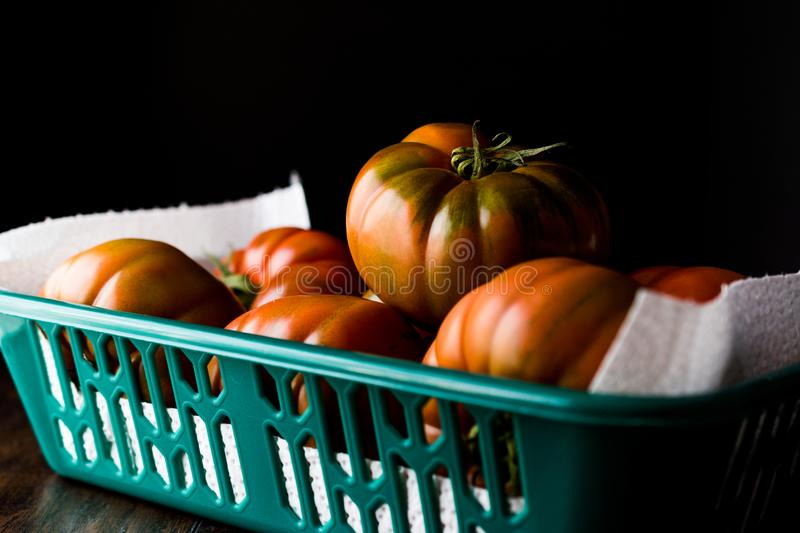 Raw Organic Red and Brown Heirloom Tomatoes. Organic Food stock photography