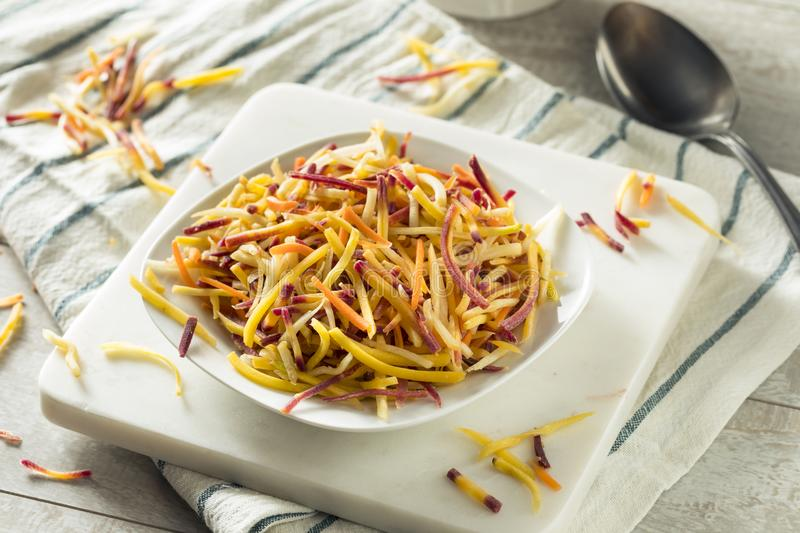 Raw Organic Shredded Heirloom Carrots. Raw Organic Shredded Red Orange and White Heirloom Carrots stock images