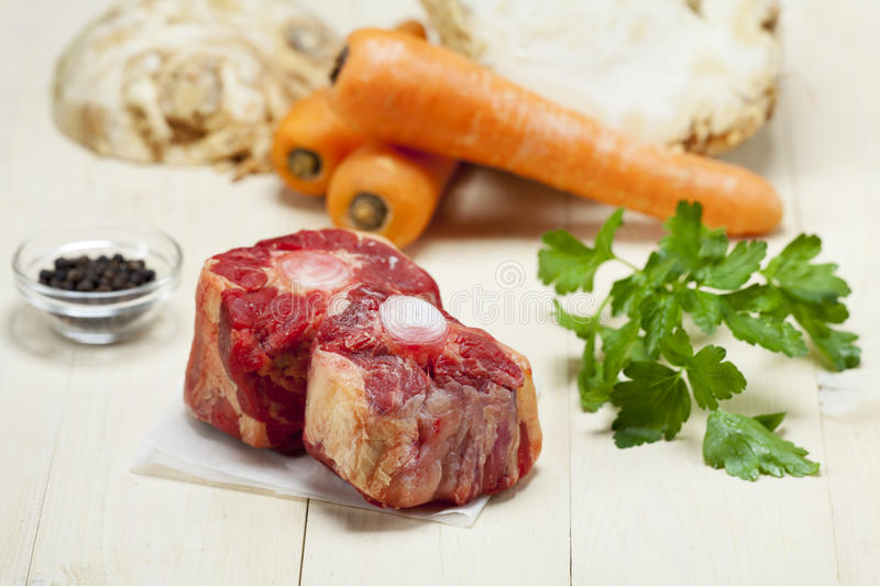 Raw ox tail. With ingredients royalty free stock photo