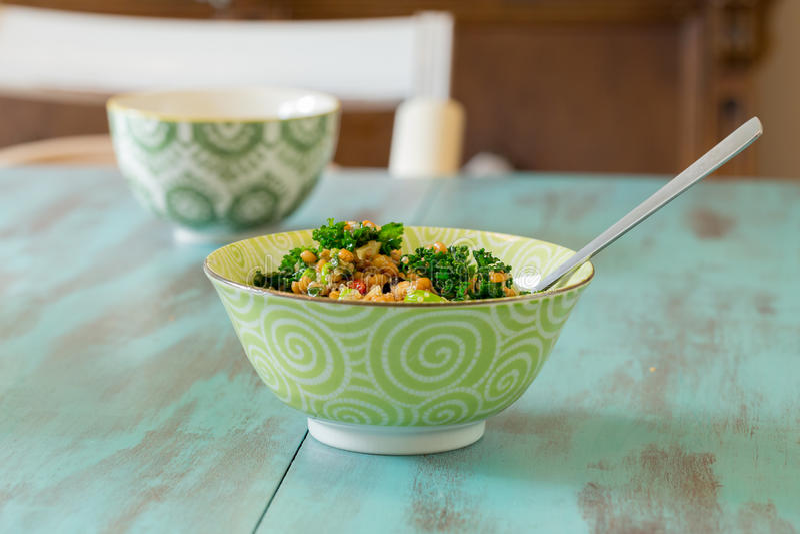 Raw Paleo Kale and Quinoa Superfood Salad royalty free stock image