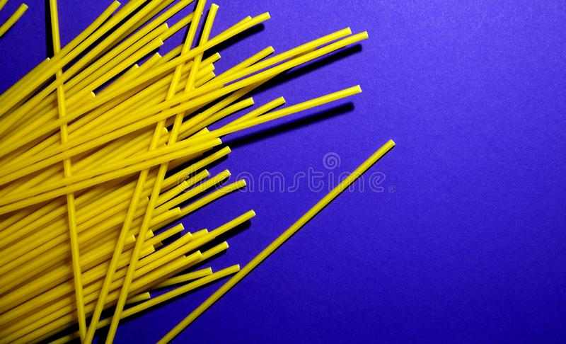 Raw spaghetti pasta on a blue background royalty free stock photos