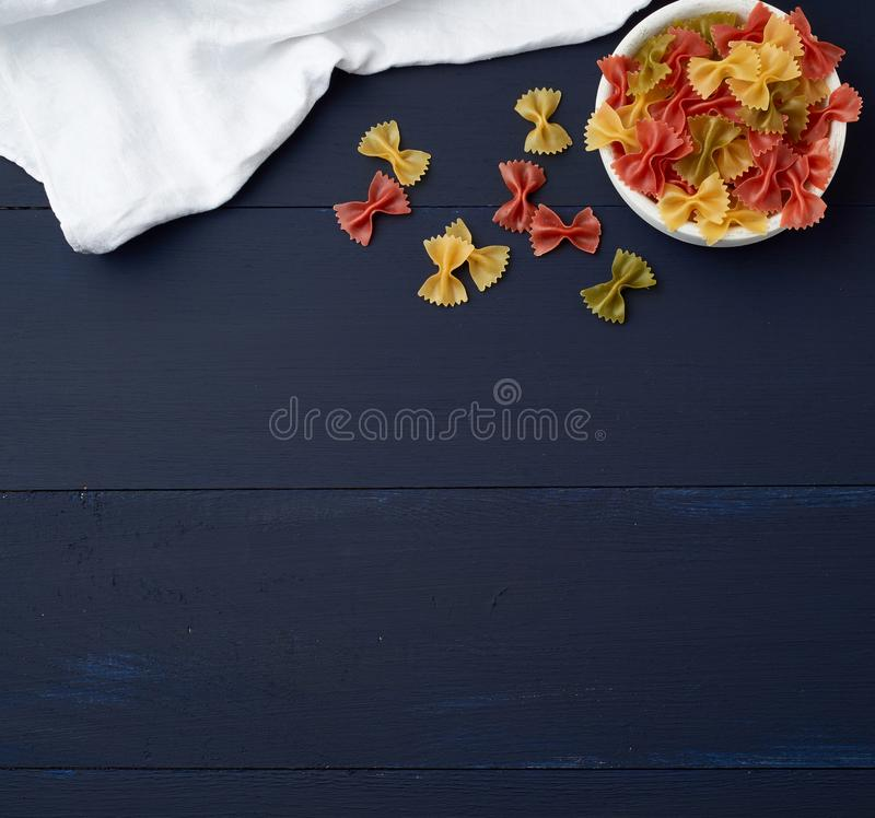 Raw pasta in the form of bows i stock photography