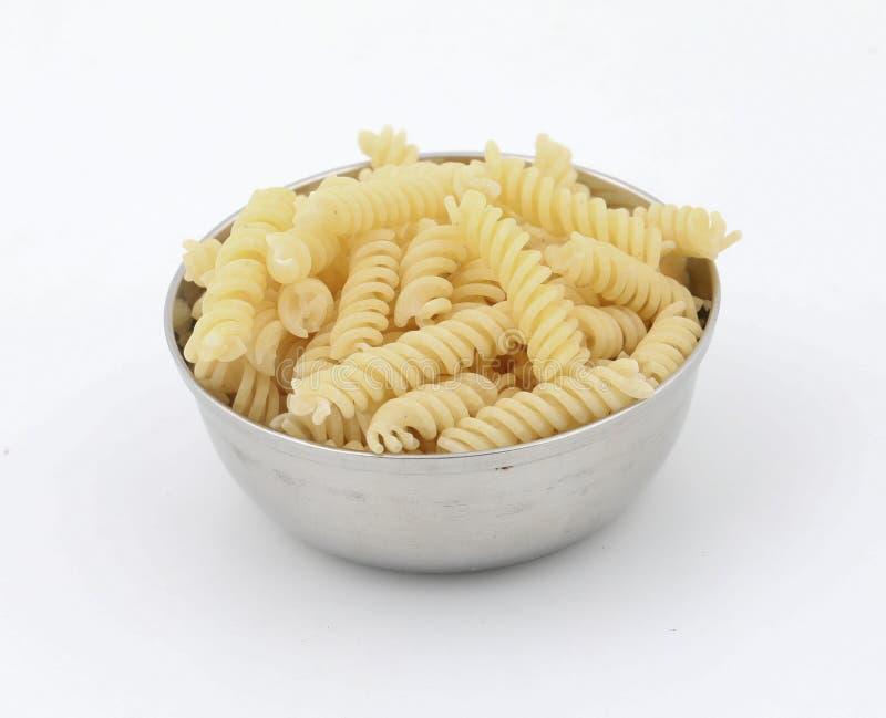 Raw Pasta. Raw italian pasta isolated on white background stock image