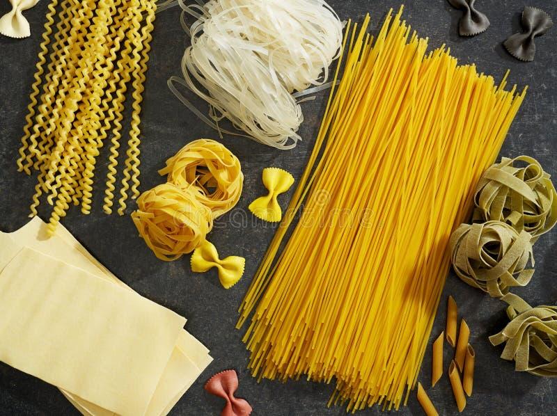 Raw pasta on wood stock photography