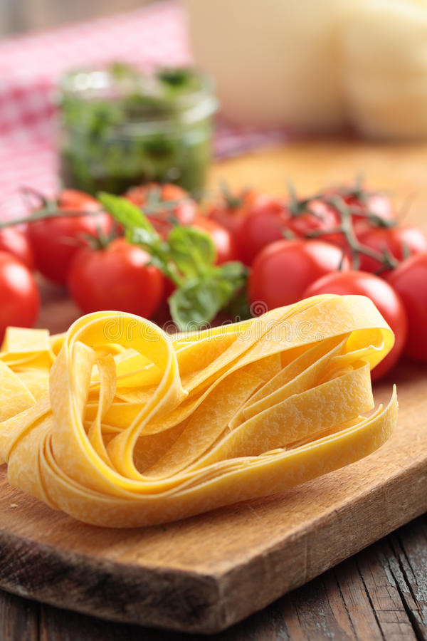 Raw pasta and vegetables stock image