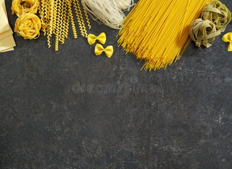 Raw pasta on wood royalty free stock photo