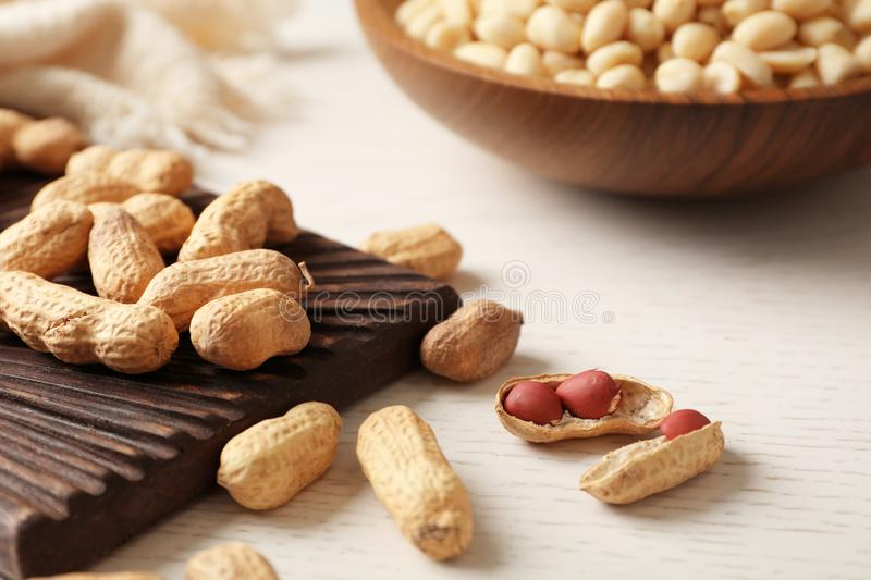 Raw peanuts in shell and board royalty free stock photography