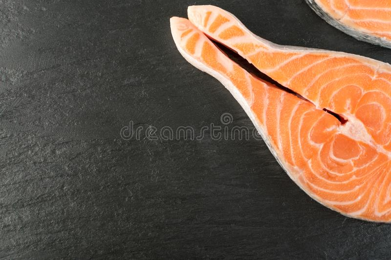 Raw Pink Salmon Steak, Red Fish, Chum or Trout Fillet on Stone royalty free stock photography