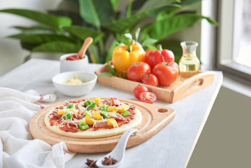 Raw pizza dough with tomato sauce, ingredients.  royalty free stock photos