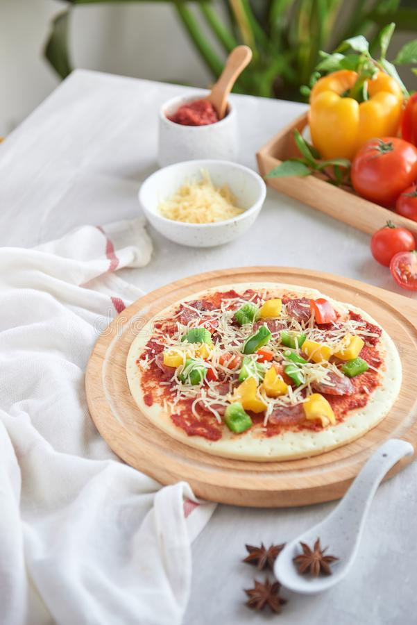 Raw pizza dough with tomato sauce, ingredients.  royalty free stock photo